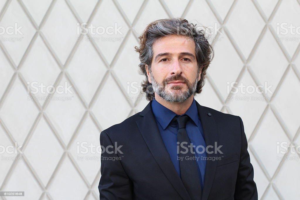 Mature elegant professional standing outside stock photo
