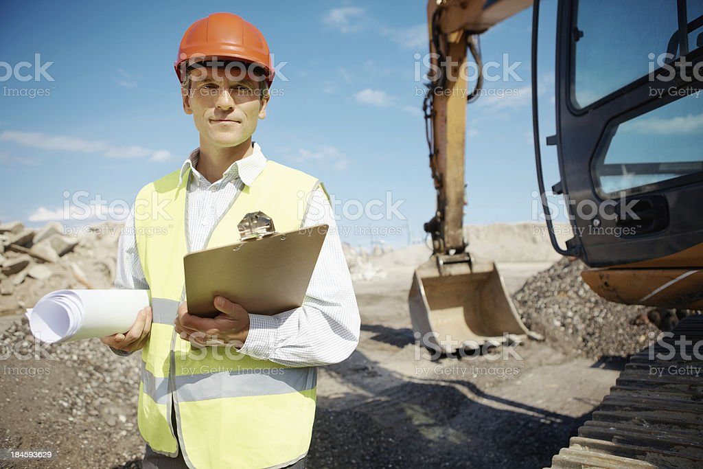 Mature engineer with blueprint royalty-free stock photo