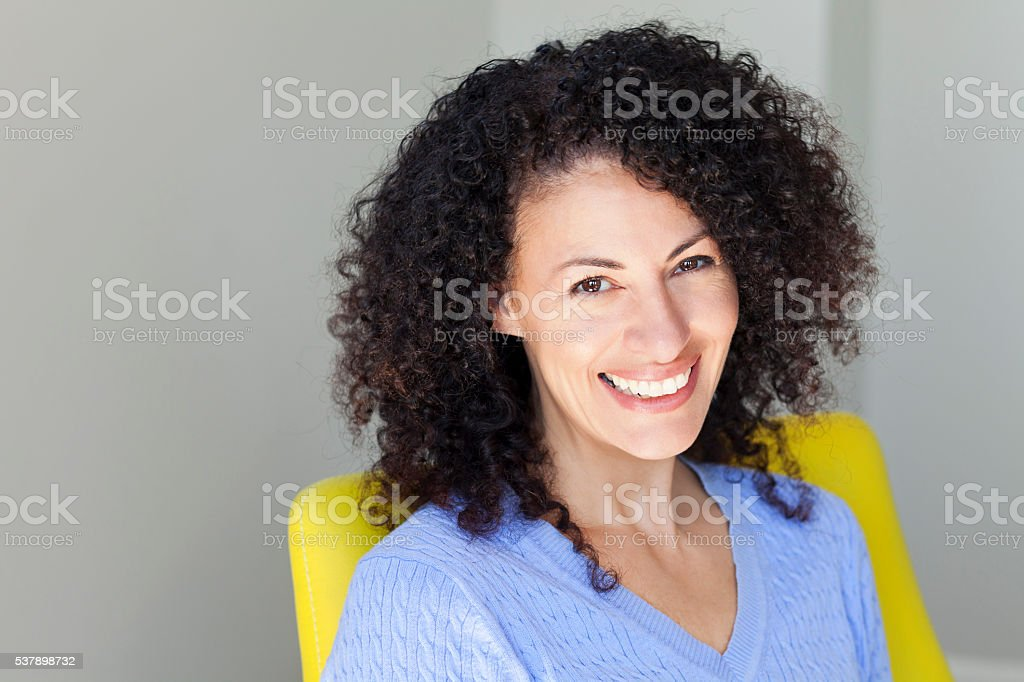 Mature Ethnic Woman Smiling At The Camera stock photo