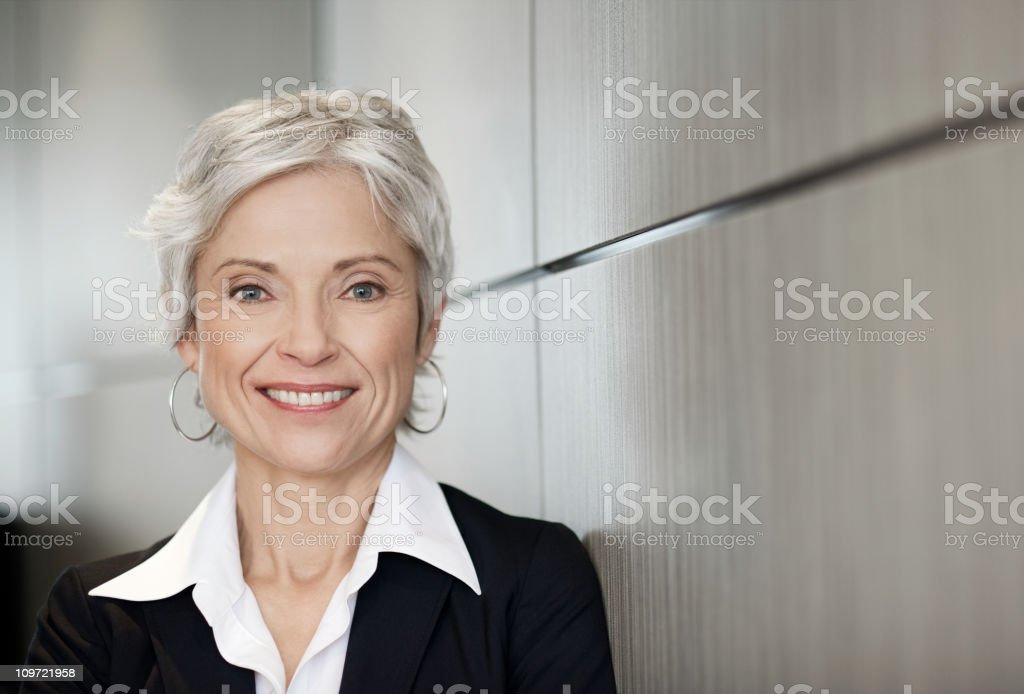 Mature executive business woman smiling stock photo
