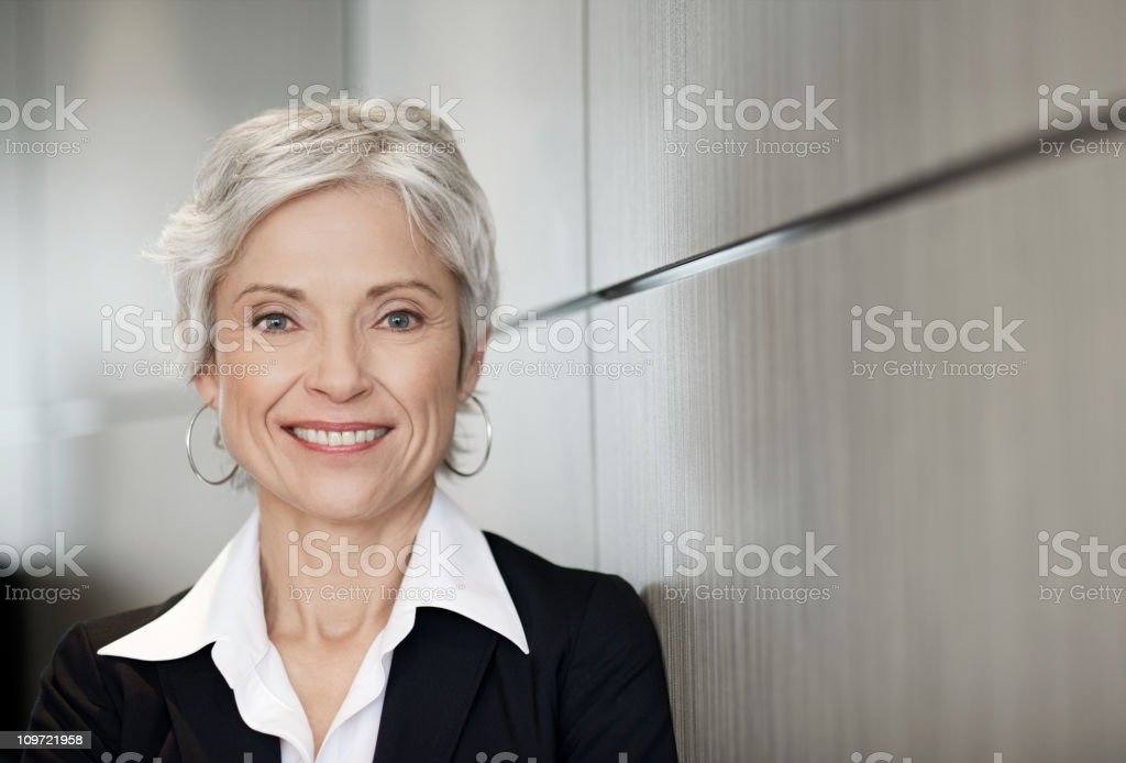 Mature executive business woman smiling stock photo
