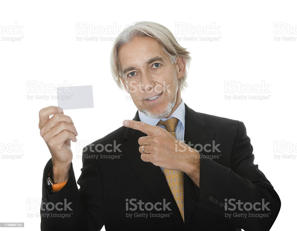 Mature executive showing a empty business card royalty-free stock photo