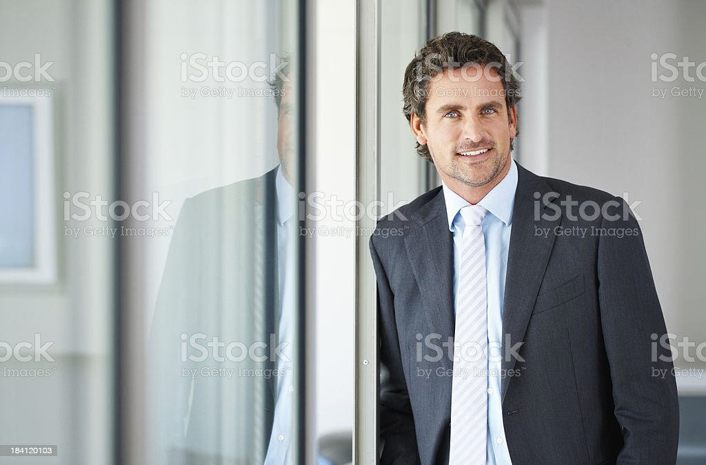 Mature executive standing against door royalty-free stock photo