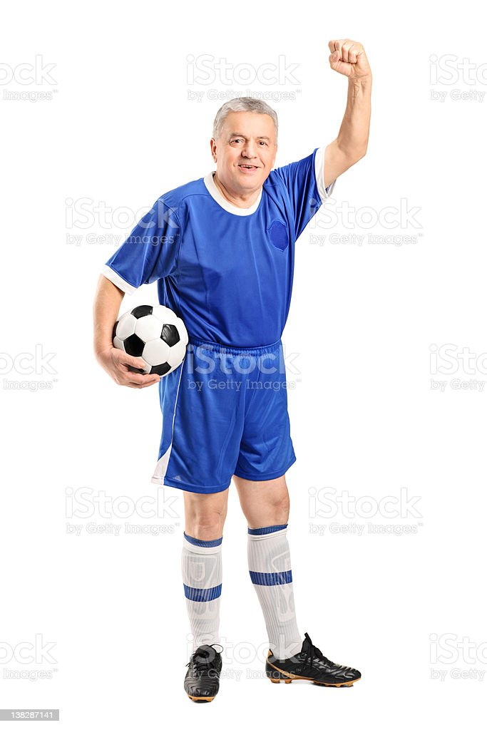 Mature fan holding a football royalty-free stock photo