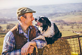 Mature Farmer and His Sheepdog