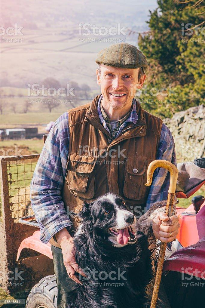 Mature Farmer and His Sheepdog stock photo