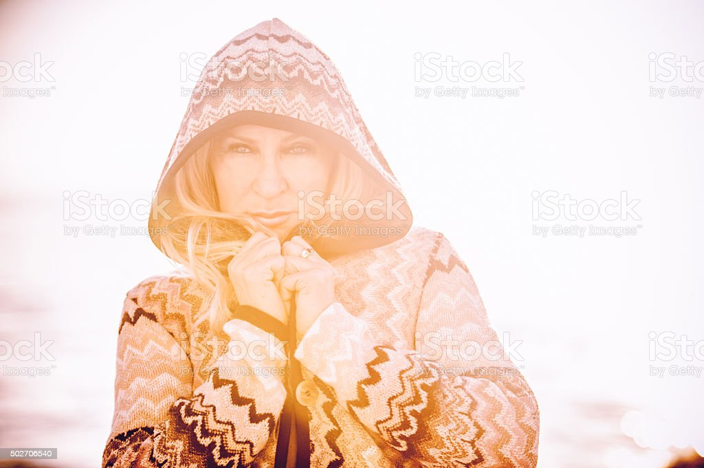 Mature Fashion Model in Knitted Winter Coat stock photo