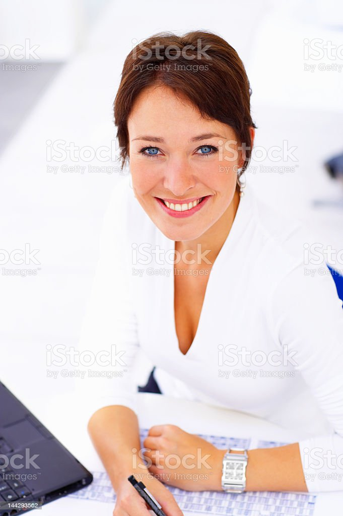 Mature female architect smiling royalty-free stock photo