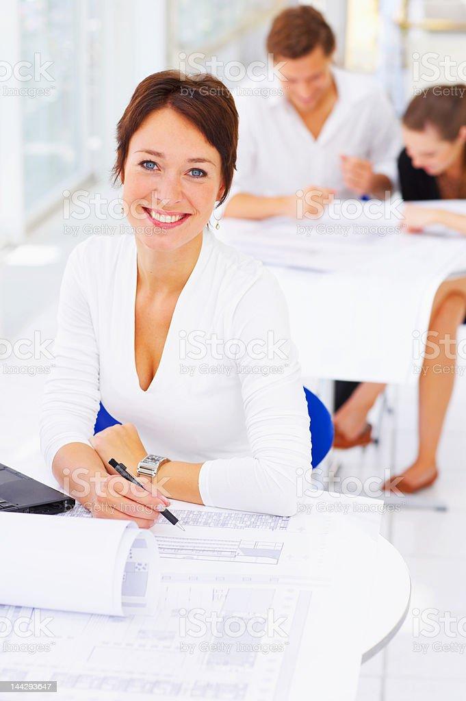 Mature female architect smiling royalty-free stock photo