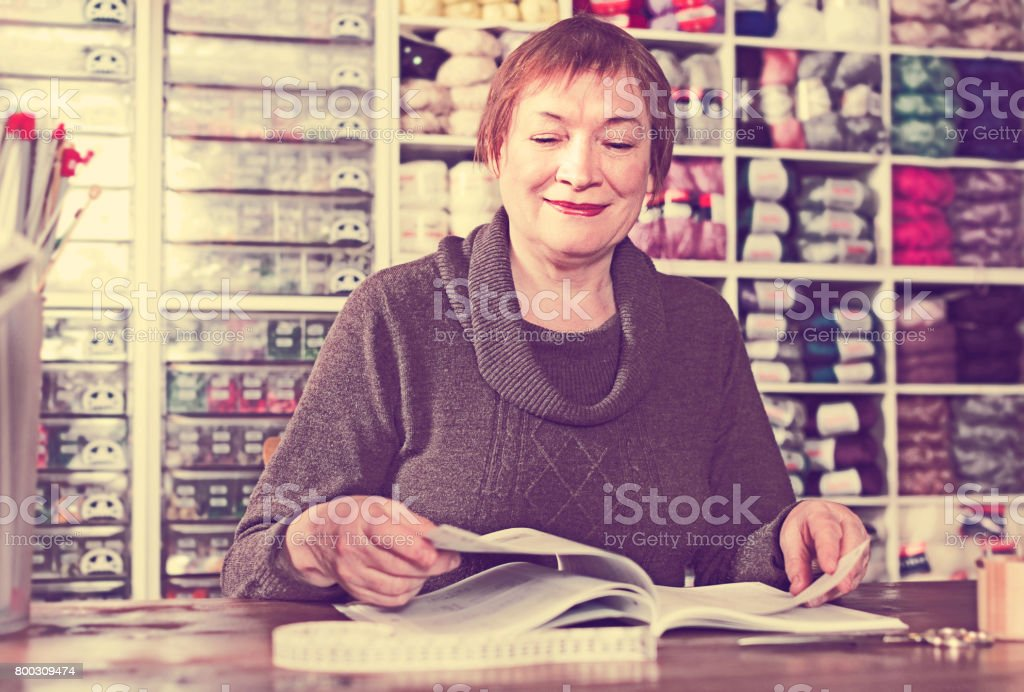 Mature female assistant waiting for clients stock photo