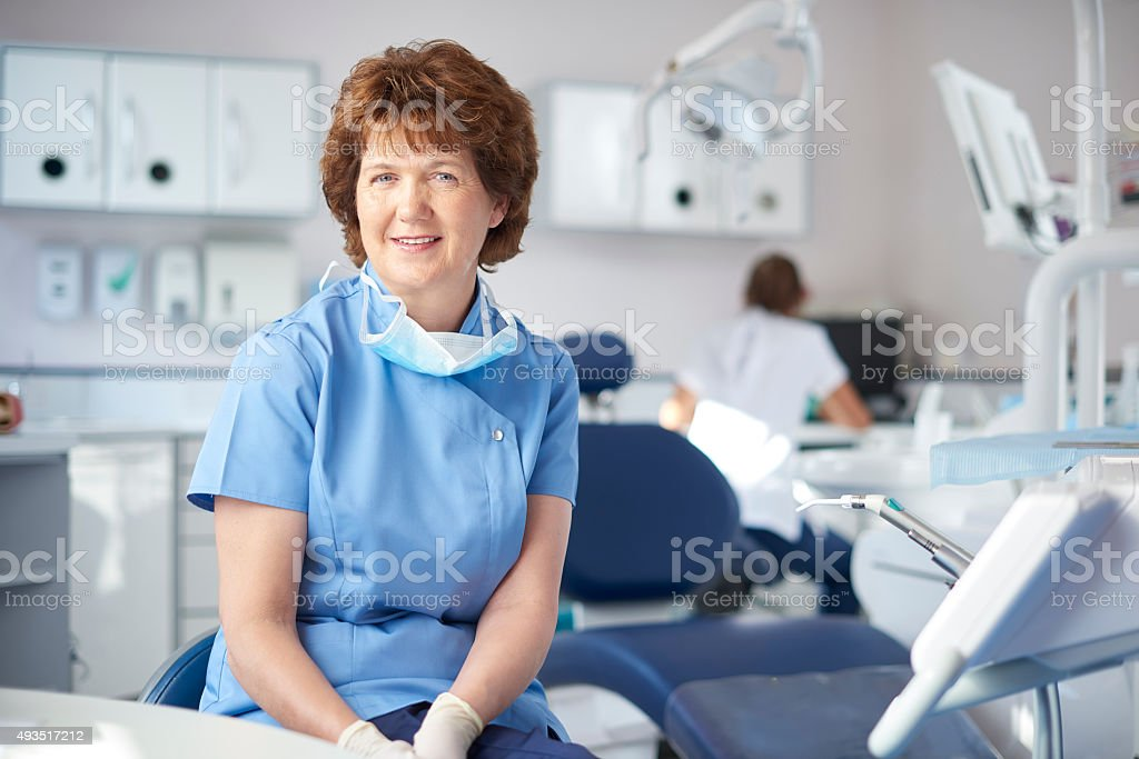 mature female dentist portrait stock photo