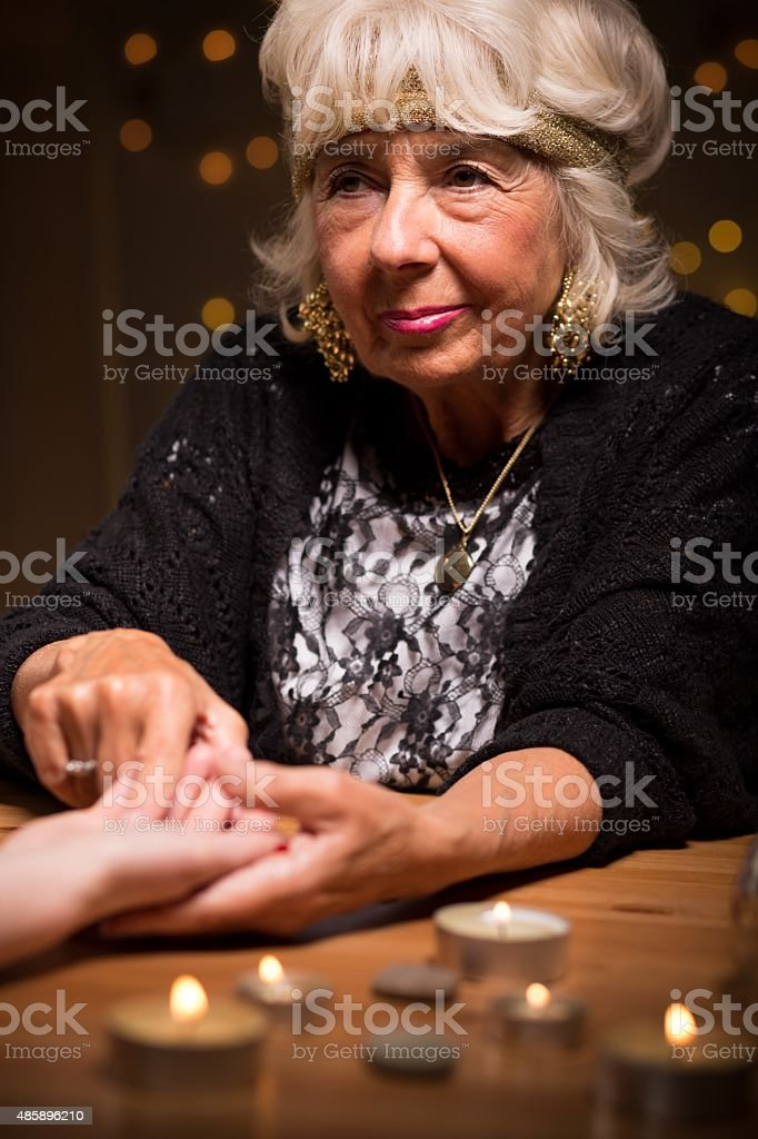 Mature female foretelling from hand stock photo