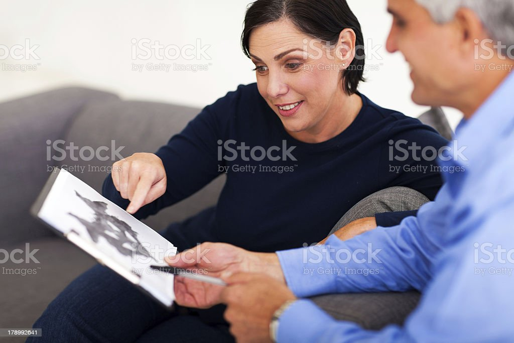 mature female patient looking at Rorschach inkblot with psychologist stock photo