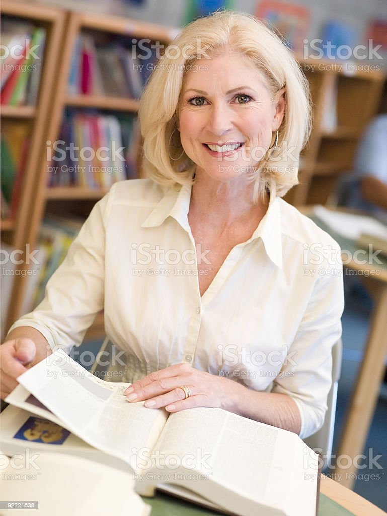 Mature female student studying royalty-free stock photo