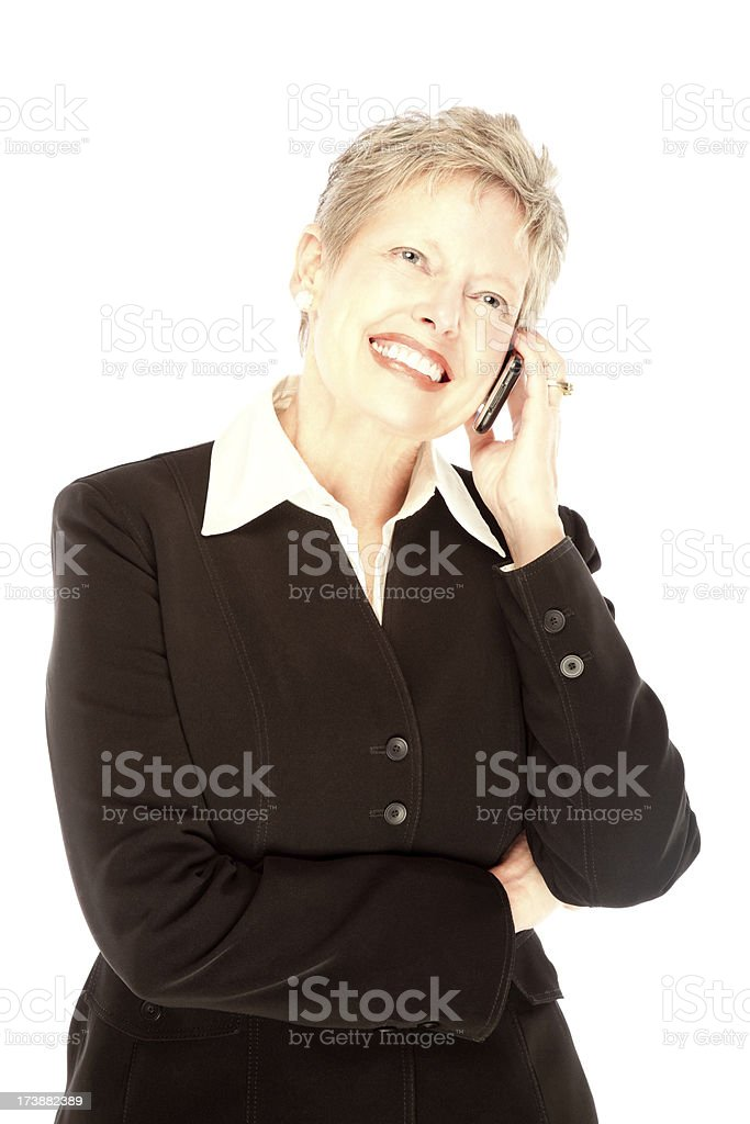 Mature female talking on mobile phone royalty-free stock photo