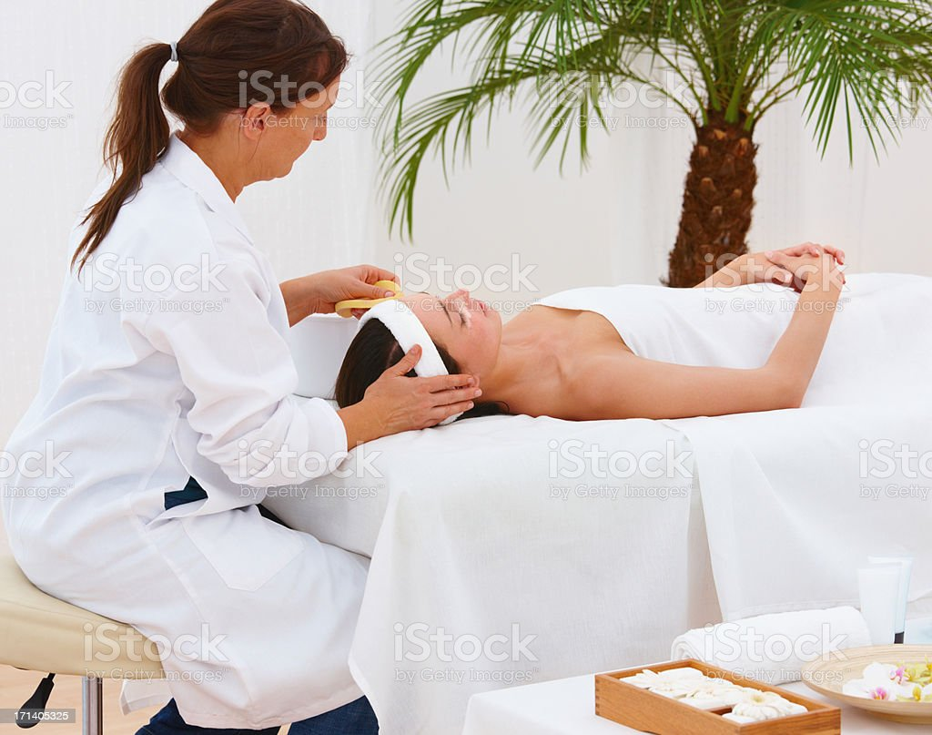 Mature female therapist working at a spa stock photo
