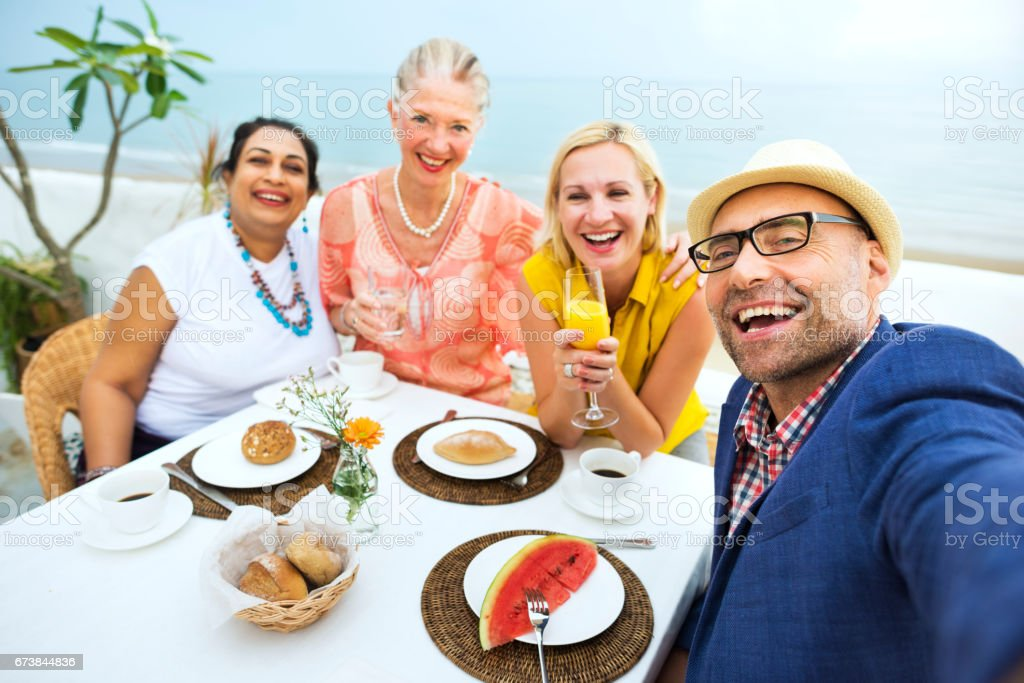 Mature Friends Fine Dining Outdoors Concept stock photo