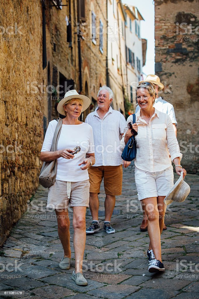 Mature Friends Looking Around Old Town Italy stock photo