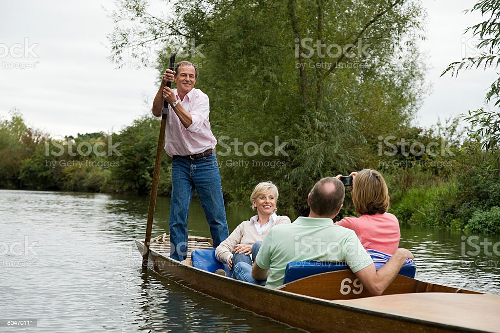 Mature friends punting royalty-free stock photo