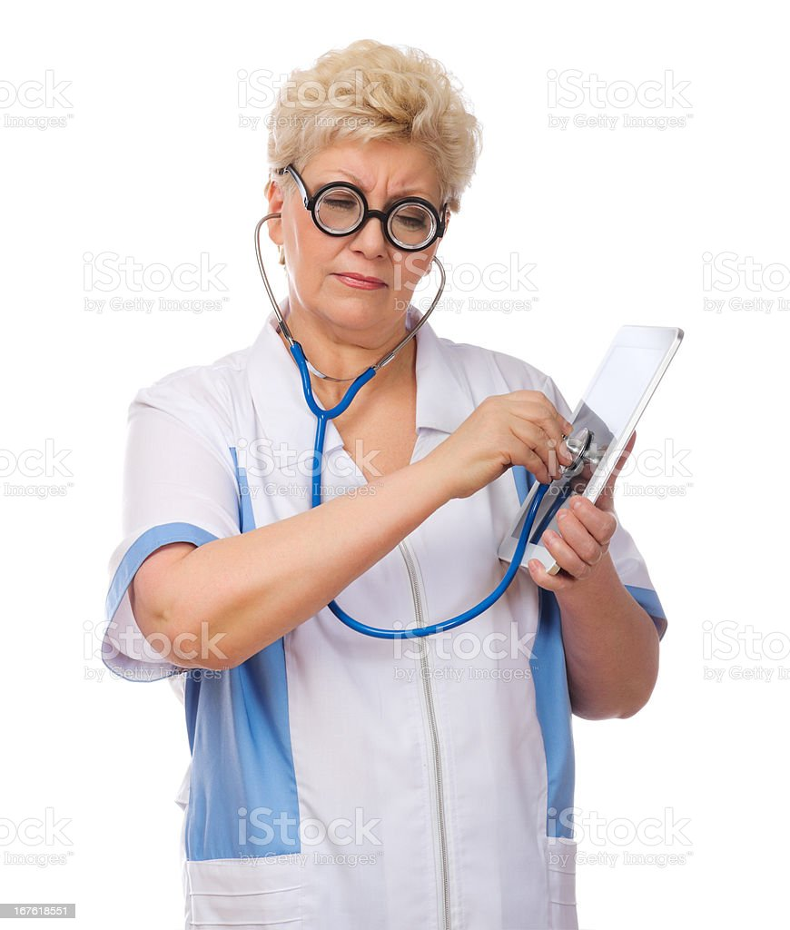Mature funny doctor listen tablet PC royalty-free stock photo