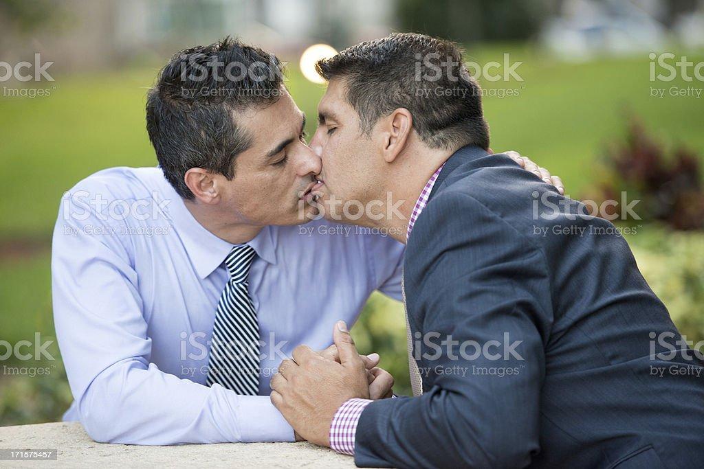 Mature Gay men kissing royalty-free stock photo