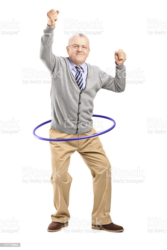 Mature gentleman dancing with a hula hoop stock photo