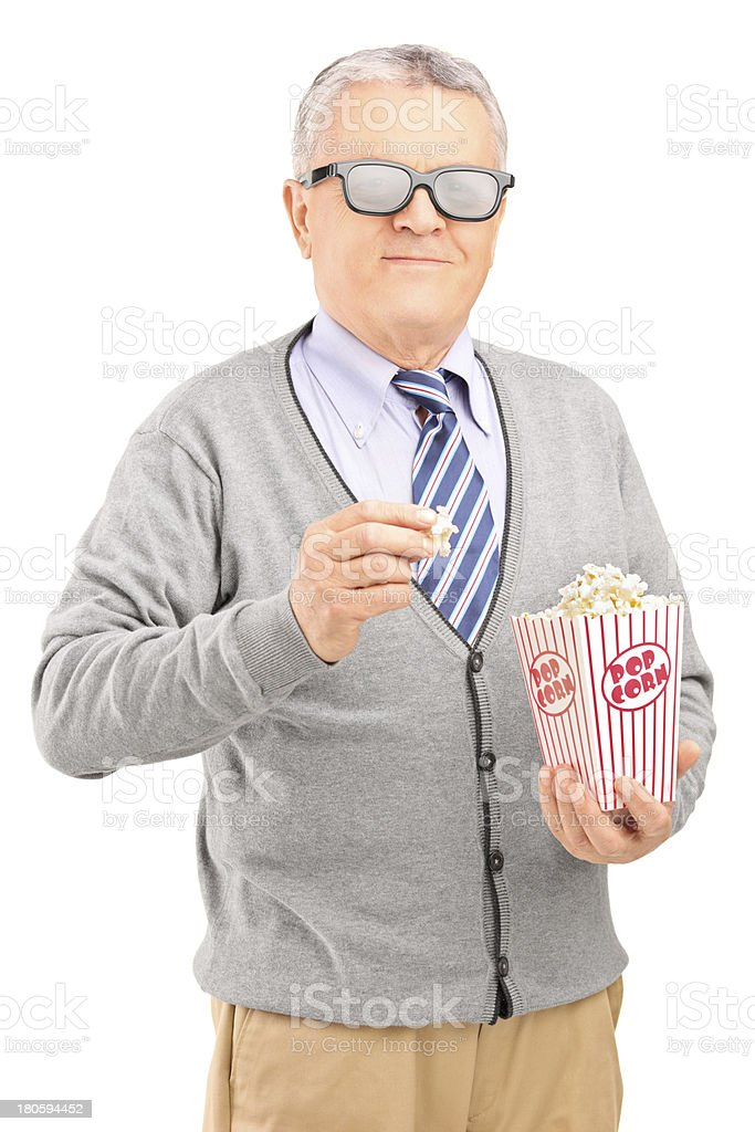 Mature gentleman eating popcorn royalty-free stock photo