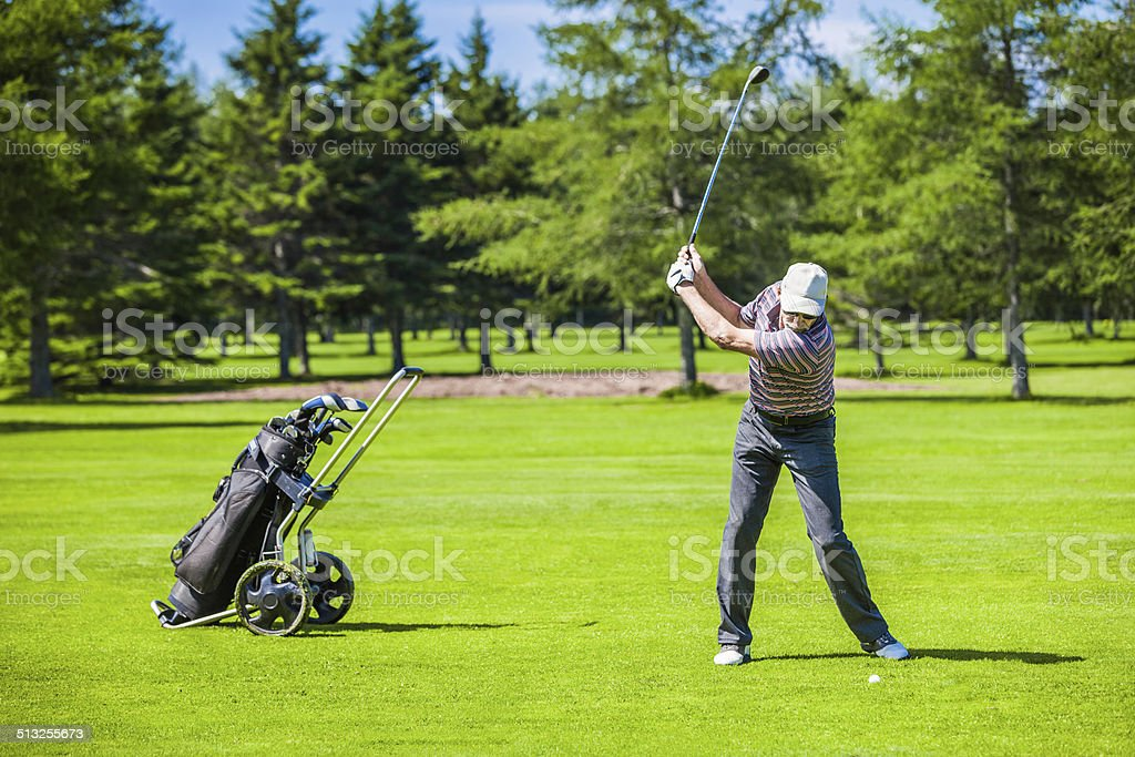 Mature Golfer on a Golf Course stock photo