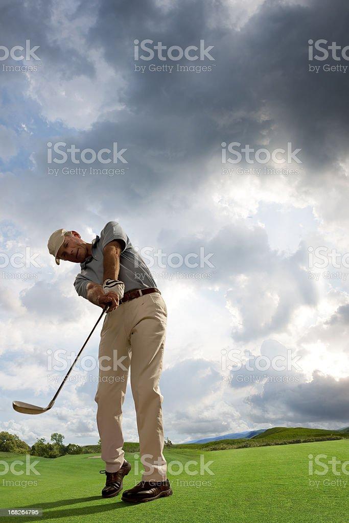 Mature Golfer Playing Golf royalty-free stock photo