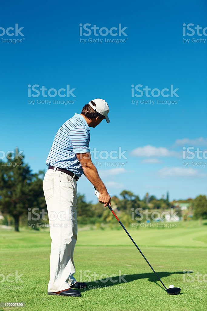 Mature golfer practicing his shots royalty-free stock photo