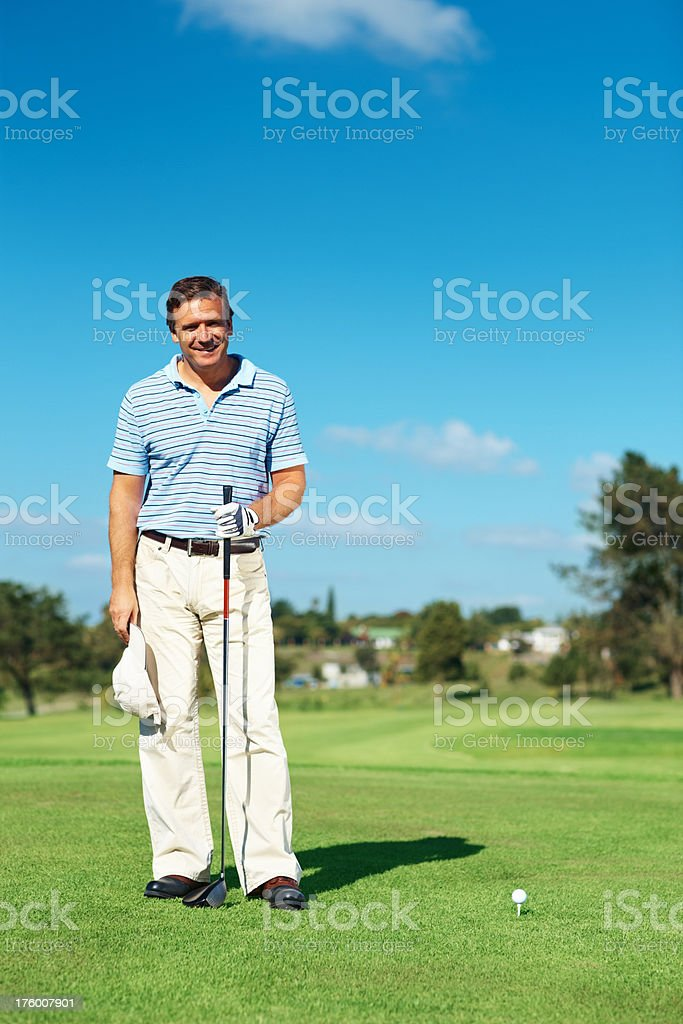 Mature golfer smiling at golf course royalty-free stock photo