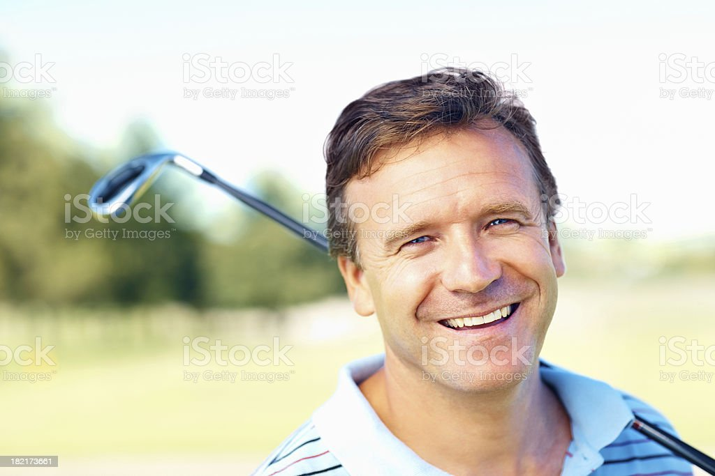 Mature golfer with a confident smile royalty-free stock photo