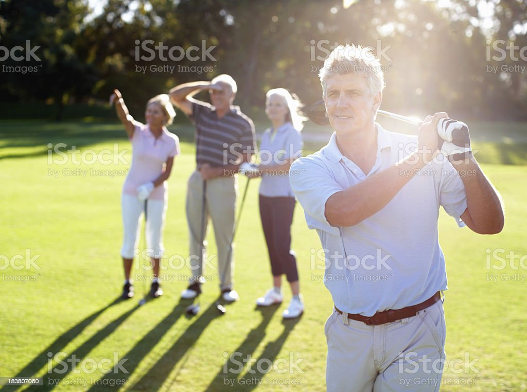 Mature golfer with a swing royalty-free stock photo