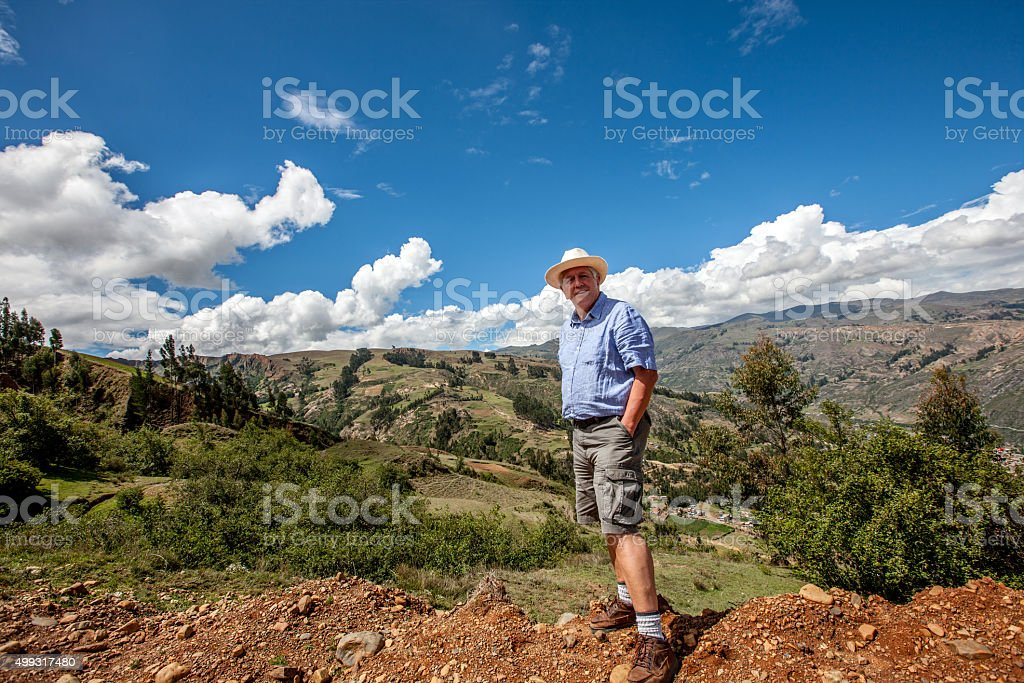 Mature gringo walking in the Andes countryside above Huaraz stock photo