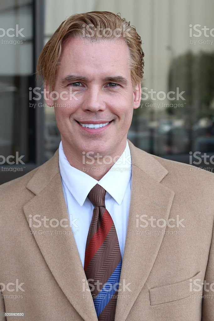 Mature handsome businessman wearing suit and tie stock photo