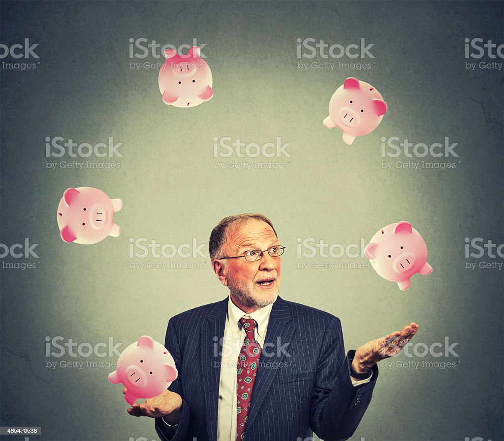 Mature happy business man juggling money stock photo