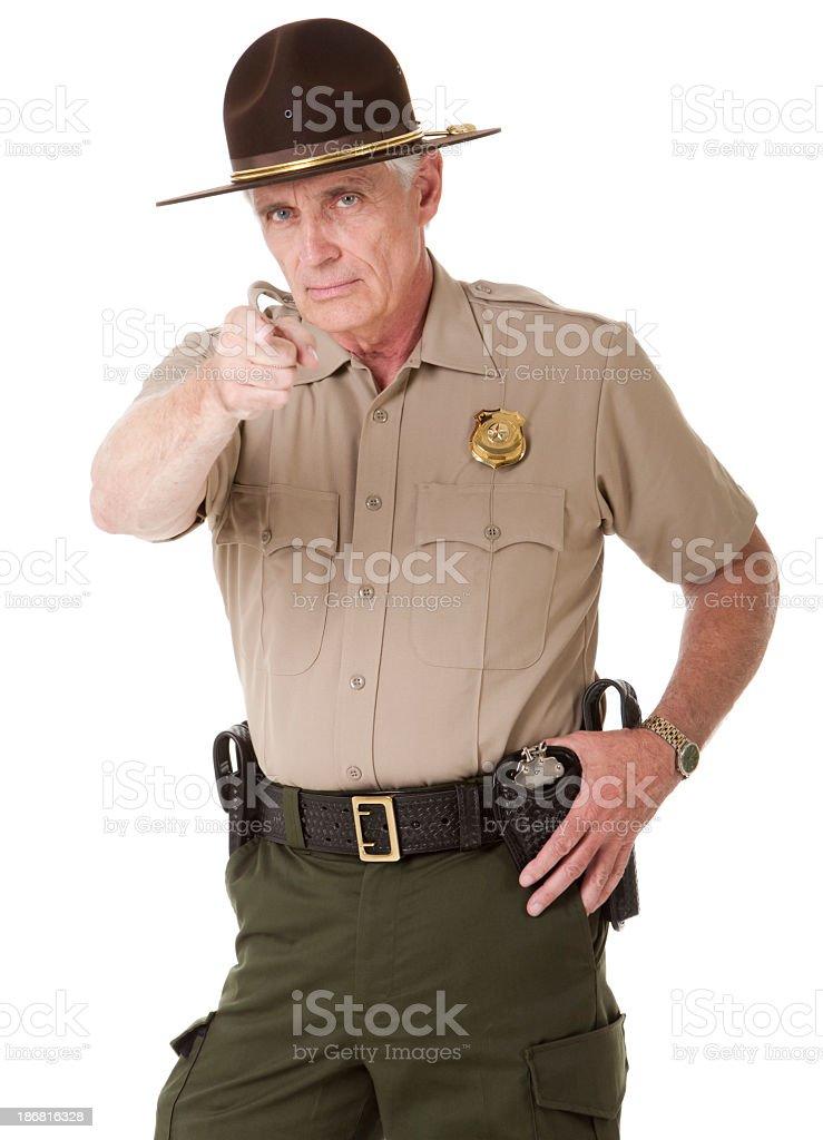 Mature Highway Patrolman Pointing royalty-free stock photo