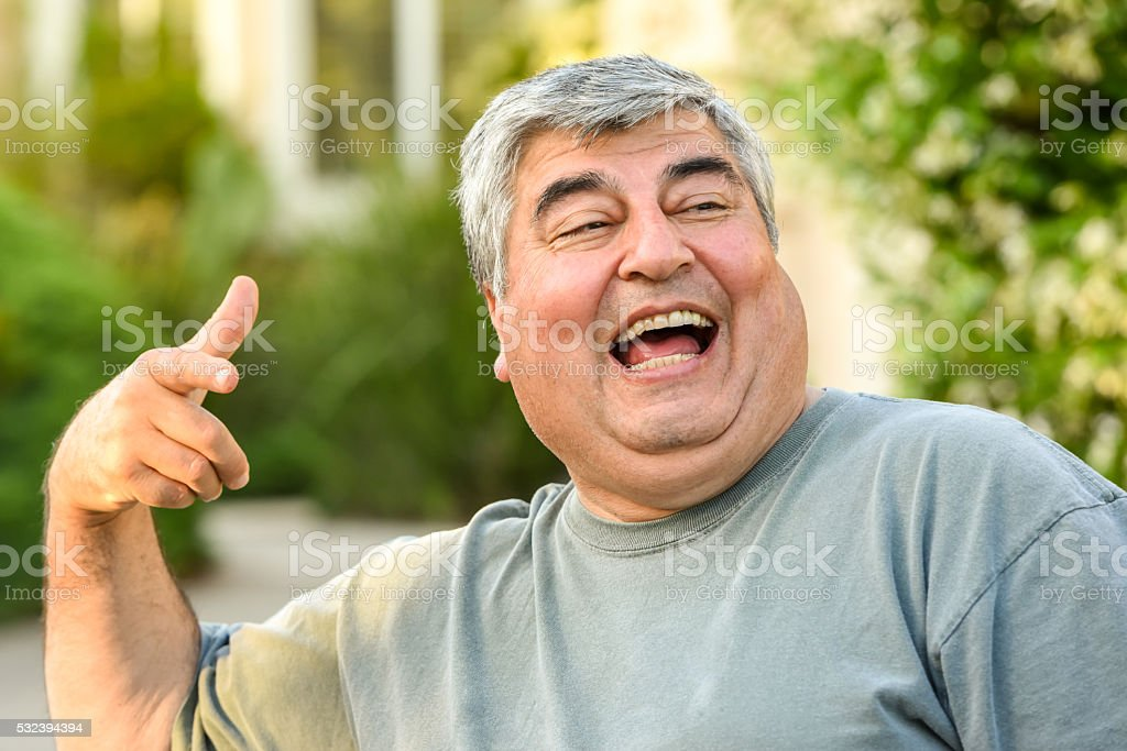 Mature hispanic man laughing stock photo