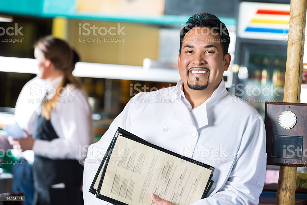 Mature Hispanic restaurant owner in local Tex-Mex diner stock photo