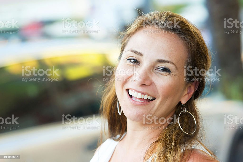 Mature hispanic woman laughing stock photo