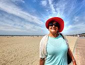 Mature hispanic woman  on beach promenade