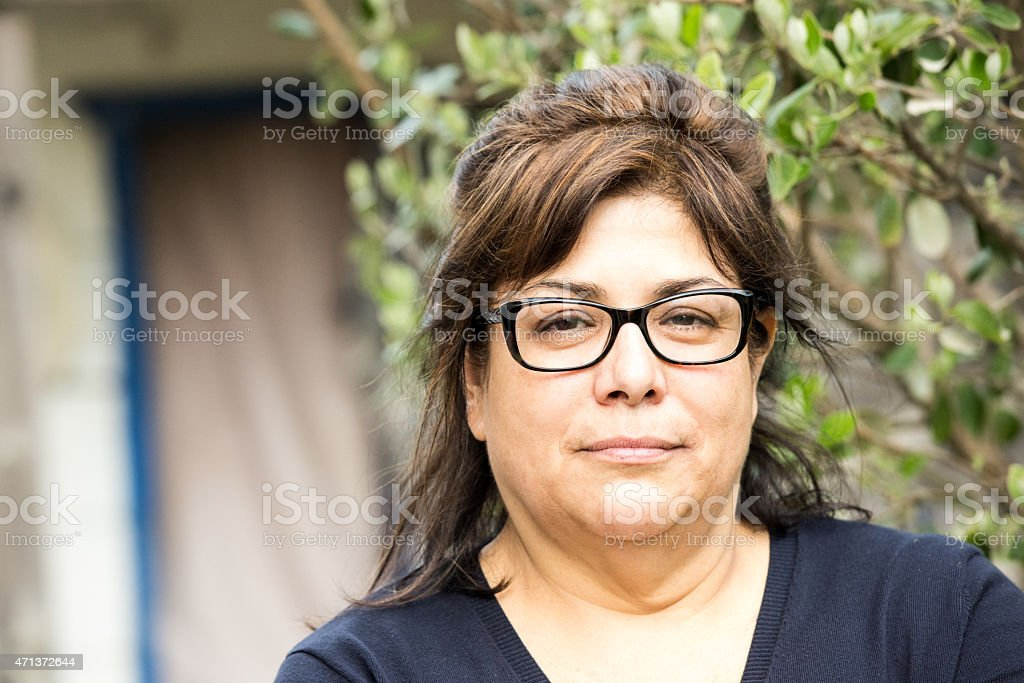mature hispanic woman stock photo