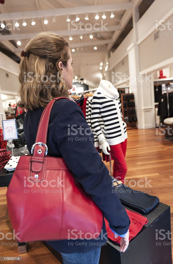Mature housewife shopping for clothes royalty-free stock photo