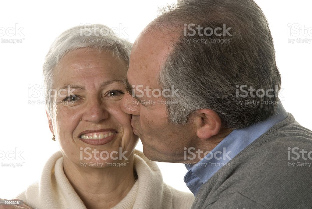 Mature husband kissing his wife royalty-free stock photo