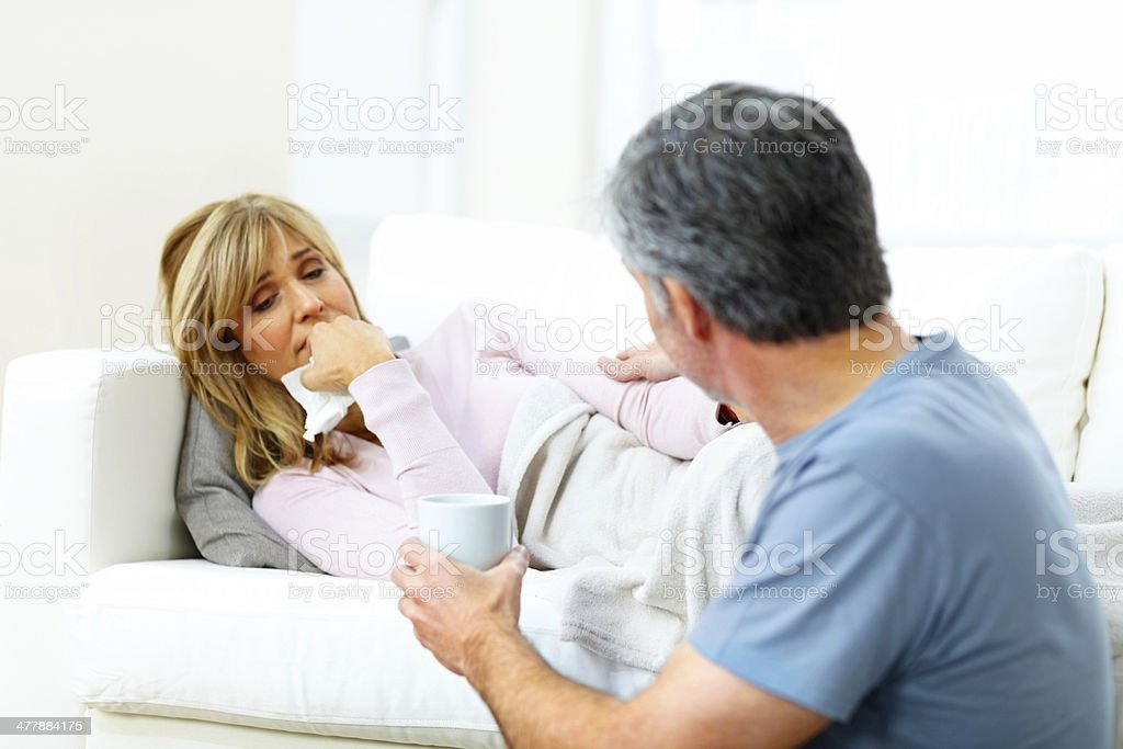 Mature husband talking care of sick wife royalty-free stock photo