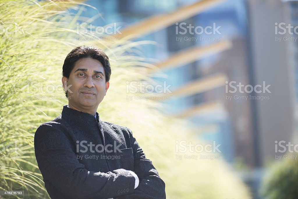 Mature, Indian Businessman with Crossed Arms royalty-free stock photo