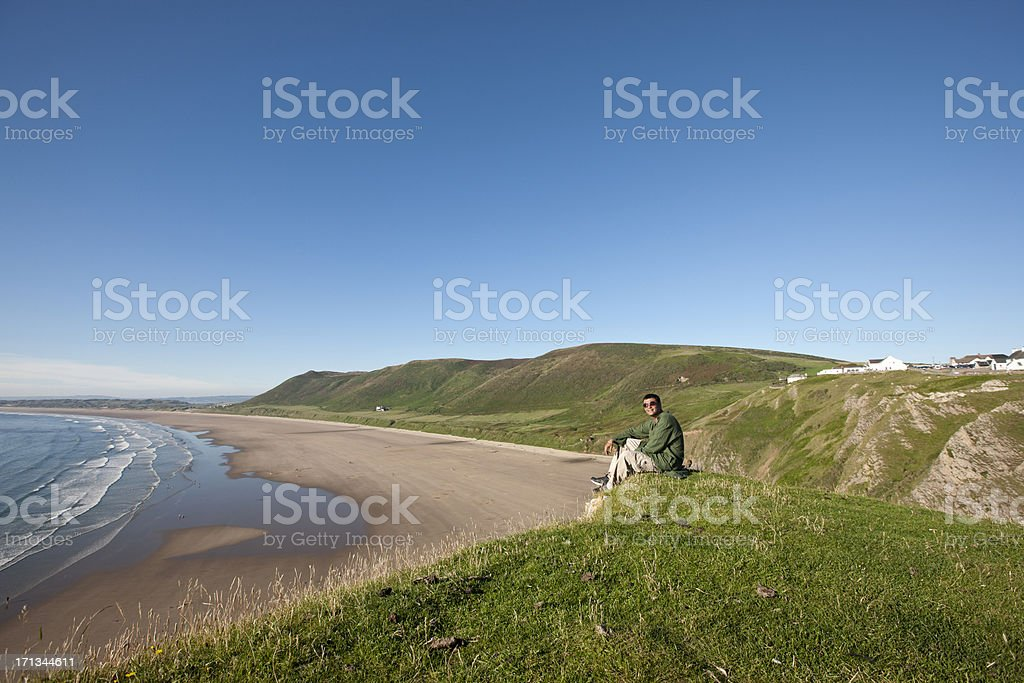 Mature indian man on Gower headland royalty-free stock photo