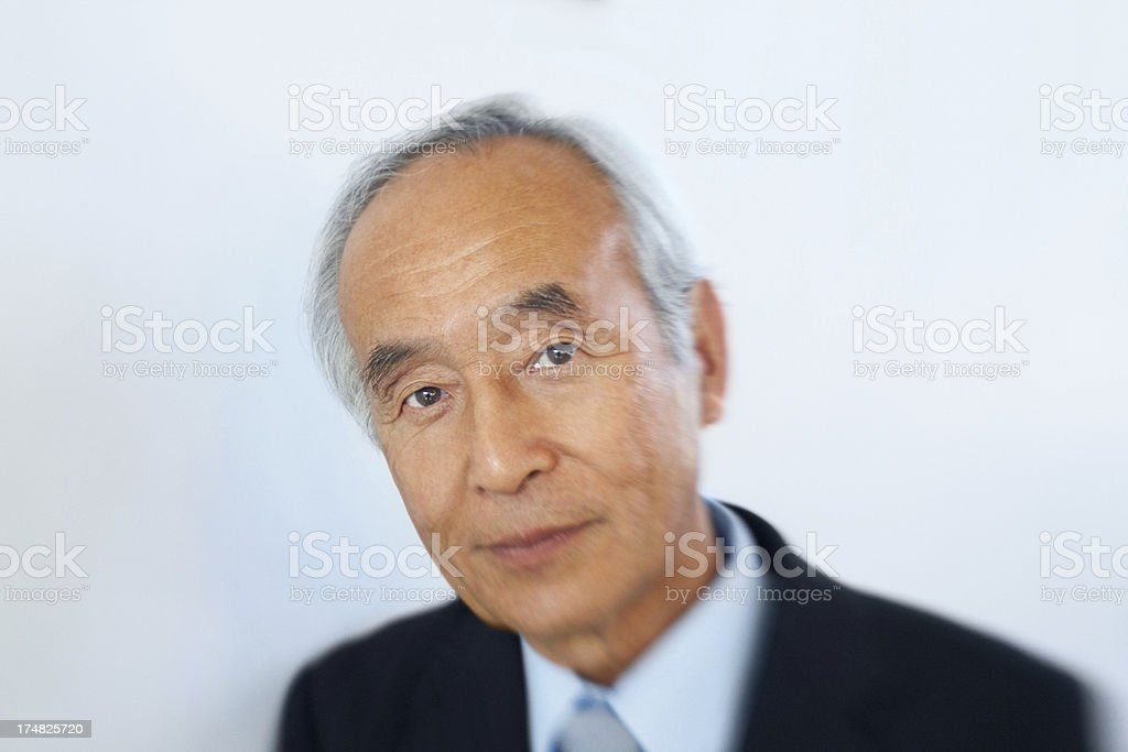Mature Japanese businessman looking at you royalty-free stock photo