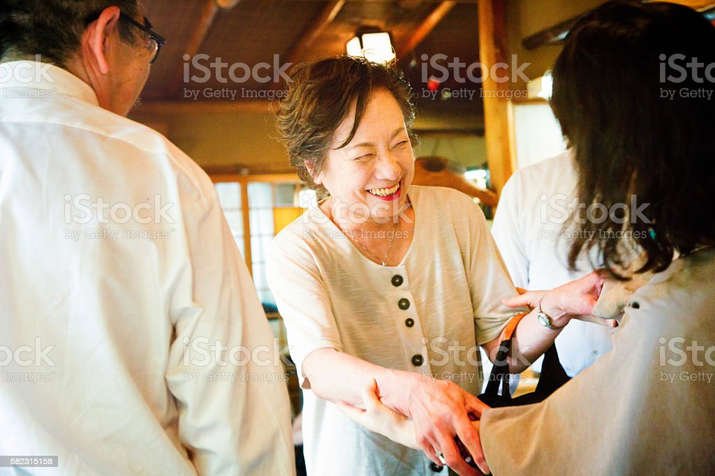 Mature Japanese female greeting an old friend stock photo