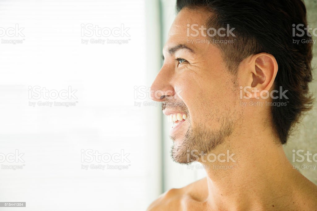 Mature Japanese man close-up profile smiling laughing stock photo